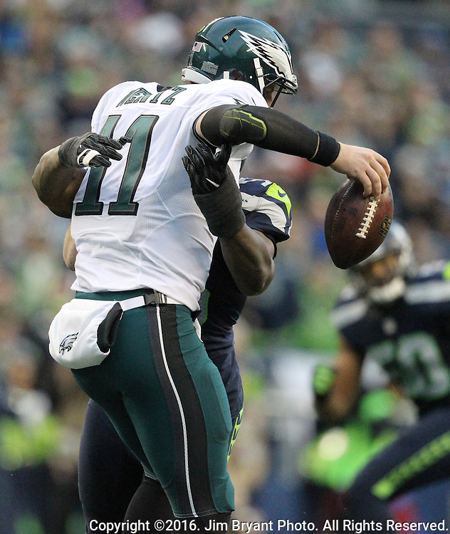 Seattle Seahawks defensive end Cliff Avril (56) forces Philadelphia Eagles quarterback Carson Wentz (11) to fumble the ball at CenturyLink Field in Seattle, Washington on November 20, 2016.  Seahawks beat the Eagles 26-15.  ©2016. Jim Bryant Photo. All Rights Reserved.