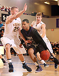 SIOUX FALLS, SD - DECEMBER 7:  Robert Goffney #15 from the University of Sioux Falls drives against Yuriy Malashenko #25 from Augustana in the first half of their game Saturday evening at the Stewart Center. (Photo by Dave Eggen/Inertia)