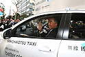 Apr. 26 - Tokyo, Japan - Kiyotake Fujii, president of Better Place's Japan operation and Head of Business Development Asia Pacific, drives the world's first switchable-battery electric taxi in Tokyo on April 26, 2010. Global electric vehicle service provider Better Place demonstrated the taxi with the Japanese Ministry of Economy, Trade, and Industry, and Tokyo's largest taxi operator Nihon Kotsu.