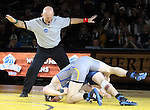 SIOUX FALLS, SD: DECEMBER 8: Referee Bud Postma signals no points in the match between Cody Pack from South Dakota State and Brayden Neises from Augustana in their 157 pound match Sunday afternoon at the Sanford Pentagon.(photo by Dave Eggen/Inertia)