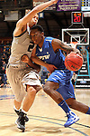 SIOUX FALLS, SD - MARCH 10:  Frank Gaines #4 from IPFW drives against Dante Williams #2 from Oakland in the second half of their quarterfinal game Sunday night at the 2013 Summit League Basketball Tournament in Sioux Falls, SD.  (Photo by Dave Eggen/Inertia)