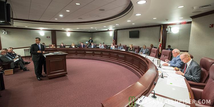 Senator Rene Garcia (R-Hialeah), left,  addresses the Florida Senate Committee on Criminal Justice committee meeting at the Florida Capitol in Tallahassee Florida March 13, 2017.