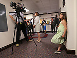Lillian, 7, waits while her mom Assemblywoman Teresa Benitez Thompson, D-Reno, answers media questions at the Legislative Building in Carson City, Nev., on Sunday, May 31, 2015.  <br /> Photo by Cathleen Allison