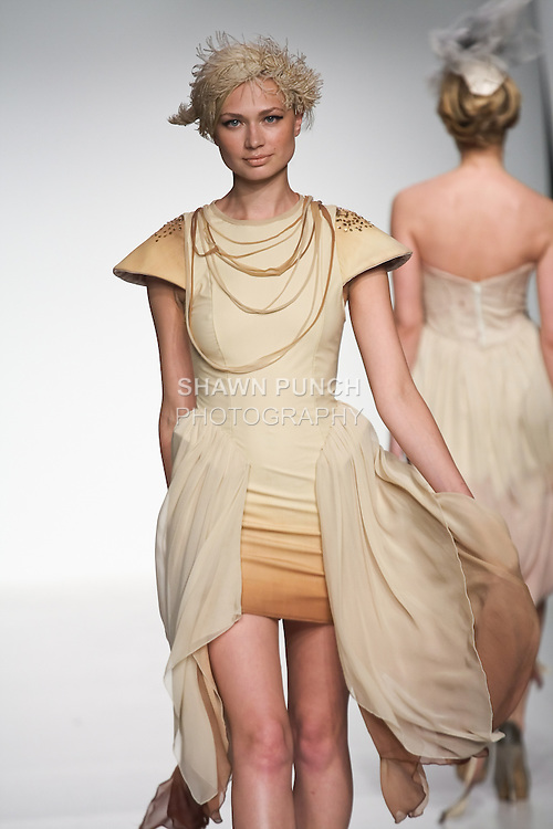 Model walks runway in an outfit from the Metamorphosis collection by Joana Rigol, during the Pratt 2011 fashion show.