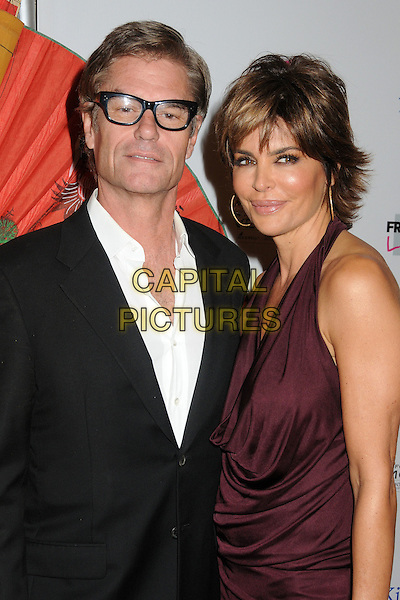 Harry Hamlin and Lisa Rinna.9th Annual 'Best in Drag Show' benefiting AID For AIDS held at the Orpheum Theatre, Los Angeles, California USA..9th October 2011.half length shirt suit dress halterneck purple aubergine married husband wife  black white glasses .CAP/ADM/BP.©Byron Purvis/AdMedia/Capital Pictures.