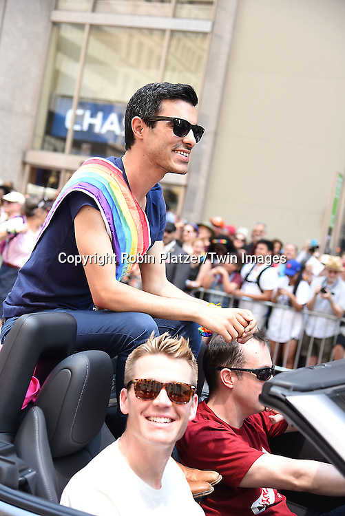 Subhi Nahas, Gay Syrian refugee, and boyfriend Mark Averette  attend the New York City Gay Pride March 2016 on June 26, 2016 on Fifth Avenue in New York City, New York, USA.<br /> <br /> photo by Robin Platzer/Twin Images<br />  <br /> phone number 212-935-0770