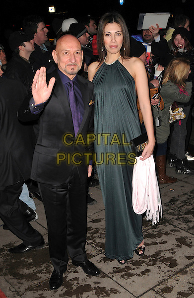 SIR BEN KINGSLEY & DANIELA BARBOSA DE CARNEIRO.London Film Critics' Circle Awards, Grosvenor House Hotel, London, England, February 4th 2009.full length hand stop gesture wife green halterneck long maxi dress black suit purple tie .CAP/CAS.©Bob Cass/Capital Pictures