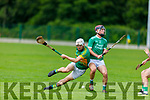 Tussle for possession between Lixnaws Ricky Heffernan  and Darragh Slattery of Ballyduff in the North Kerry Senior Hurling Championship.