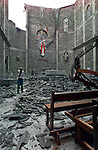 1/31/99 AL DIAZ/HERALD STAFF--At the Sacred Heart of Jesus Catholic Church in Armenia,parishioner JAIME BARON becomes emotional. He was viewing the extensive roof damage after attending Mass outside the church.