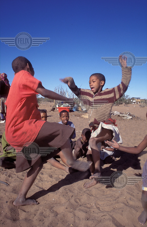 © Paul Weinberg / Panos Pictures..Ghansi, BOTSWANA..San children dancing.