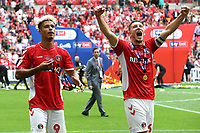 Lyle Taylor and Jason Pearce of Charlton celebrate their victory and promotion to the Championship during Charlton Athletic vs Sunderland AFC, Sky Bet EFL League 1 Play-Off Final Football at Wembley Stadium on 26th May 2019