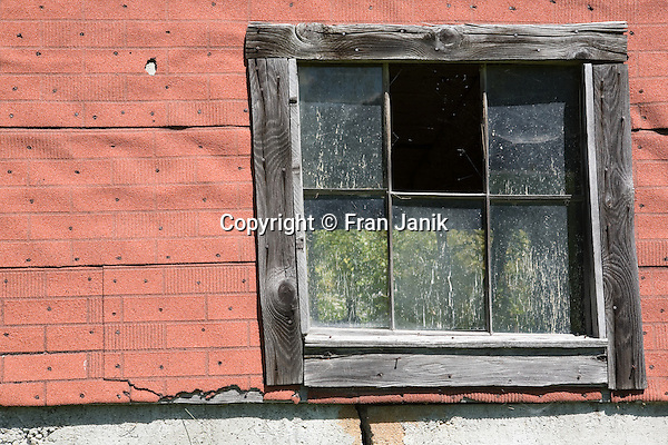The window of a Dairy Farmers barn is captured on a sunny day in Eden Vermont. The town of Eden is located in northen Vermont.