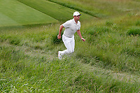 Rory McIlroy (NIR) jogs to the 15th tee during the second round of the 118th U.S. Open Championship at Shinnecock Hills Golf Club in Southampton, NY, USA. 15th June 2018.<br /> Picture: Golffile | Brian Spurlock<br /> <br /> <br /> All photo usage must carry mandatory copyright credit (&copy; Golffile | Brian Spurlock)