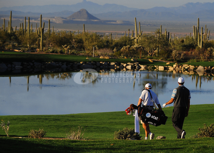 Feb 24, 2009; Marana, AZ, USA; Tiger Woods (right) walks with caddie Steve Williams during a practice round prior to the World Golf Championships-Accenture Match Play Championship at the Ritz-Carlton Golf Club, Dove Mountain.  Mandatory Credit: Mark J. Rebilas-