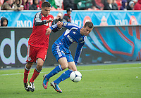 20 October 2012: Toronto FC midfielder Luis Silva #11 and Montreal Impact midfielder Jeb Brovsky #15 in action during an MLS game between the Montreal Impact and Toronto FC at BMO Field in Toronto, Ontario Canada. ..