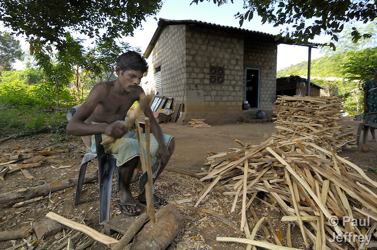 A fisherman displaced by the 2004 tsunami in Sri Lanka is forced to chop and sell firewood for a living. While aid groups have done a lot to reequip fishing families along the Sri Lankan coast, in this area armed conflict between government forces and Tamil rebels has led the government military to impose harsh restrictions, including not allowing him to fish.
