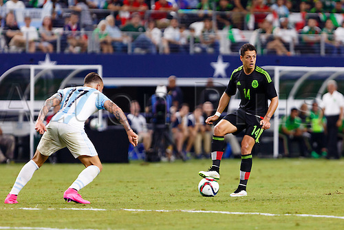 08.09.2015. Arlington, Texas, USA.  Mexico Forward Javier Hernandez (14) looks to make a pass with Argentina Defender Nicolas Otamendi (17) guarding during the international friendly soccer match between the Argentina and Mexico National Teams played at AT&T Stadium in Arlington, TX.