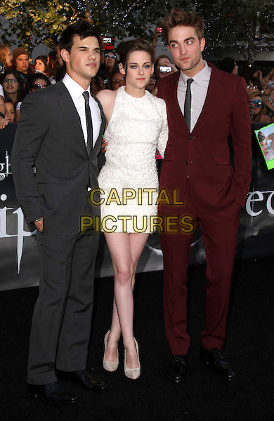 "TAYLOR LAUTNER, KRISTEN STEWART & ROBERT PATTINSON .""The Twilight Saga: Eclipse"" Los Angeles Film Premiere at the 2010 Los Angeles Film Festival held at Nokia Theatre LA Live,  Los Angeles, California, USA, 24th June 2010..full length cast red burgundy suit grey gray shirt tie maroon white dress.CAP/ADM/CH.©Charles Harris/AdMedia/Capital Pictures"