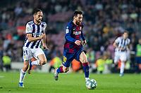 29th October 2019; Camp Nou, Barcelona, Catalonia, Spain; La Liga Football, Barcelona versus Real Valladolid; Lionel Messi breaks away from Michel of Valladolid - Editorial Use