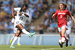 06 October 2013: North Carolina's Crystal Dunn (19) shoots past Maryland's Lauren Berman (11). The University of North Carolina Tar Heels hosted the University of Maryland Terrapins at Fetzer Field in Chapel Hill, NC in a 2013 NCAA Division I Women's Soccer match. UNC won the game 3-1.