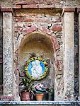 Roadside shrine, small Italian village of Mezzana, Tuscano, Italy