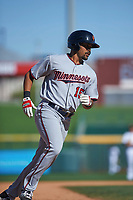 Surprise Saguaros right fielder LaMonte Wade (15), of the Minnesota Twins organization, rounds the bases after hitting a home run during an Arizona Fall League game against the Mesa Solar Sox on October 20, 2017 at Sloan Park in Mesa, Arizona. The Solar Sox walked-off the Saguaros 7-6.  (Zachary Lucy/Four Seam Images)