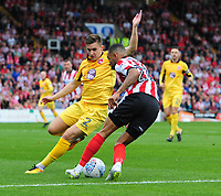 Lincoln City's Nathan Arnold crosses the ball despite the attentions of Morecambe's Aaron McGowan<br /> <br /> Photographer Chris Vaughan/CameraSport<br /> <br /> The EFL Sky Bet League Two - Lincoln City v Morecambe - Saturday August 12th 2017 - Sincil Bank - Lincoln<br /> <br /> World Copyright &copy; 2017 CameraSport. All rights reserved. 43 Linden Ave. Countesthorpe. Leicester. England. LE8 5PG - Tel: +44 (0) 116 277 4147 - admin@camerasport.com - www.camerasport.com