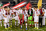 Abdel Aziz Hatim of Qatar (C) poses for photos with his trophy during the AFC Asian Cup UAE 2019 Final match between Japan (JPN) and Qatar (QAT) at Zayed Sports City Stadium  on 01 February 2019 in Abu Dhabi, United Arab Emirates. Photo by Marcio Rodrigo Machado / Power Sport Images