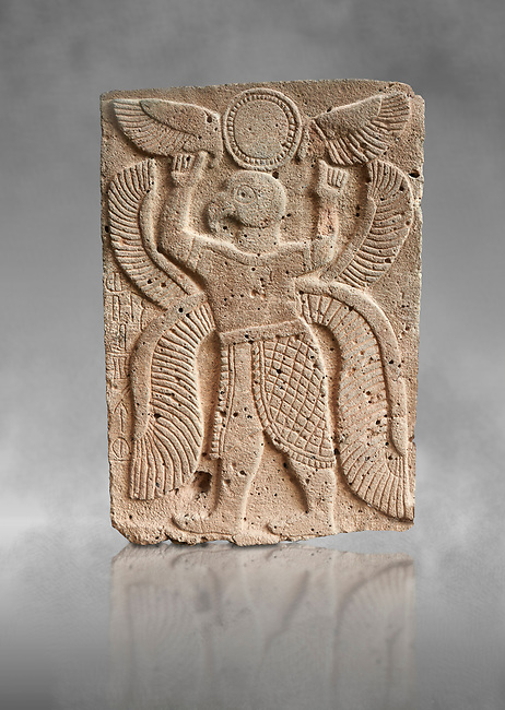 Pictures & images of the North Gate Hittite sculpture stele depicting a winged bird God. 8the century BC.  Karatepe Aslantas Open-Air Museum (Karatepe-Aslantaş Açık Hava Müzesi), Osmaniye Province, Turkey. Against grey art background