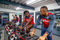 (L-R) Wilfried Bony and Jordan Ayew exercise on bikes during the Swansea City training session at The Fairwood training Ground, Swansea, Wales, UK. Thursday 16 November 2017