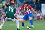 Kenan Kodro of Club Atletico Osasuna competes for the ball with Filipe Luis of Atletico de Madrid  during the match of La Liga between  Atletico de Madrid and Club Atletico Osasuna at Vicente Calderon  Stadium  in Madrid, Spain. April 15, 2017. (ALTERPHOTOS / Rodrigo Jimenez)