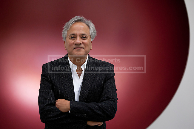 09/10/2012. LONDON, UK. Artist Anish Kapoor stands in front of his sculpture 'Hollow' (2012) at a press view ahead of his new exhibition at the Lisson Gallery in London today (09/12/12) . The exhibition, the first since the artists solo exhibition at the Royal Academy of the Arts in 2009, features new works by Kapoor and runs from the 10th of October to the 10th of November 2012. Photo credit: Matt Cetti-Roberts