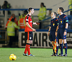 Rangers captain Lee Wallace with the linesman and referee at the end of the match querying the sending off of Andy Halliday