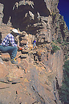 Leslie Jahnke Overhanging Cliff To Do Measurements With Richard Lang, Mustang Ridge, Apache Reservation