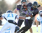 SIOUX FALLS, SD - NOVEMBER 8: David Clark #4 from the University of Sioux Falls slips the grasp of Chris Smith #21 from Upper Iowa following an interception in the second quarter of their game Saturday afternoon at Bob Young Field in Sioux Falls.  (Photo by Dave Eggen/Inertia)
