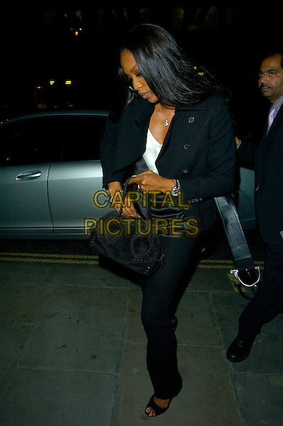 "NAOMI CAMPBELL.""Swimming With Sharks"" - gala performance, Vaudeville Theatre, London, England..October 17th, 2007.full length black trousers jacket bag purse looking down open toe shoes .CAP/CAN.©Can Nguyen/Capital Pictures"