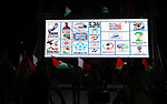 Palestinians gather in Gaza city as the official logo of the FIFA World Cup Qatar 2022 is projected on a screen on September 3, 2019. Qatar unveiled the logo for the 2022 World Cup which will be hosted by the Gulf emirate, displaying it in public spaces in Doha and cities around the world. Photo by Mahmoud Nasser