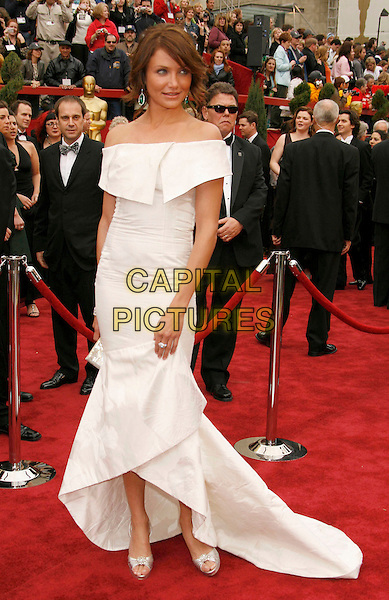 CAMERON DIAZ.The 79th Annual Academy Awards - Arrivals held at the Kodak Theatre, Hollywood, California, USA,.25 February 2007..oscars red carpet full length white off the shulder dress green dangly earrings ring bracelet jewellery silver strappy shoes sandals.CAP/ADM/RE.©Russ Elliot/AdMedia/Capital Pictures.