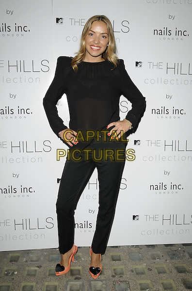 ELEN RIVAS .The Hills Collection launch party, Nails Inc. shop, South Molton St., London, England..full length black top sheer see through thru bra trousers pink coral peach peep toe shoes heart hands on hips shoulder pads nail varnish polish .CAP/CAN.©Can Nguyen/Capital Pictures.