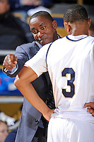 25 February 2010:  FIU Basketball Head Coach Isiah Thomas speaks with Tremayne Russell (3) during the first half as the Middle Tennessee Blue Raiders defeated the FIU Golden Panthers, 74-71, at the U.S. Century Bank Arena in Miami, Florida.