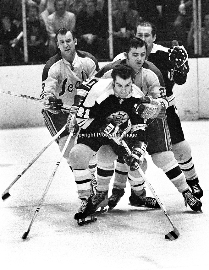 Seals vs Boston: 1971 , Gerry Ehman and Ernie Hicke.with Bruins Don Marcotte..photo/Ron Rieterer