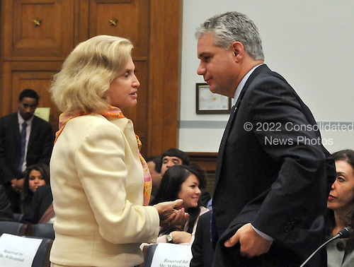 "Washington, D.C. - October 7, 2008 -- Eric R. Dinallo, Superintendent, New York State Insurance Department, right, shakes speaks with United States Representative Carolyn Maloney (Democrat of New York), left, following his testimony before the United States House  Committee on Oversight and Government Reform hearing on ""The Causes and Effects of the AIG Bailout"" in the Rayburn House Office Building on Tuesday, October 7, 2008..Credit: Ron Sachs / CNP.(RESTRICTION: NO New York or New Jersey Newspapers or newspapers within a 75 mile radius of New York City)"
