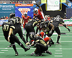 SIOUX FALLS, SD - JUNE 23:  Rachman Crable #52 from the Sioux Falls Storm leaps to get a finger on the ball for a block against the Lee Valley Steelhawks in the first quarter of their first round playoff game Saturday night at the Sioux Falls Arena. (Photo by Dave Eggen/Inertia)