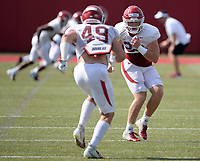 NWA Democrat-Gazette/ANDY SHUPE<br /> Arkansas linebackers Hayden Henry (right) and McKinley Williams run through a drill Tuesday, Aug. 13, 2019, during practice at the university practice facility in Fayetteville. Visit nwadg.com/photos to see photographs from the practice.