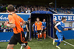 Queen of the South 2 Stranraer 0, 11/08/2015. Scottish Challenge Cup first round, Palmerston Park. The opposing teams running on to the pitch at Palmerston Park, Dumfries, before Queen of the South (in blue) hosted Stranraer in a Scottish Challenge Cup first round match. The game was the opening match of the season in a competition open to sides below the Scottish Premiership. Queen of the South won the match 2-0, watched by a crowd of 1229 spectators. Photo by Colin McPherson.