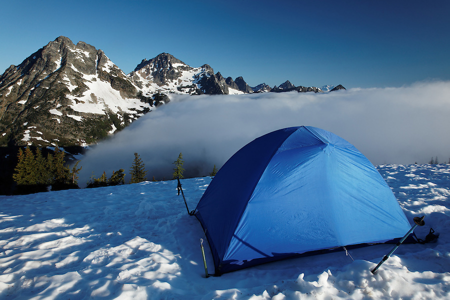 Backpacking tent in snow camp, Maple Pass, North Cascades, Washington, USA