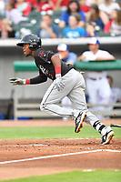 Birmingham Barons left fielder Luis Basabe (3) runs to first base during a game against the Tennessee Smokies at Smokies Stadium on May 15, 2019 in Kodak, Tennessee. The Smokies defeated the Barons 7-3. (Tony Farlow/Four Seam Images)