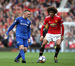 Wayne Rooney of Everton shadowed by Marouane Fellaini of Manchester United during the premier league match at the Old Trafford Stadium, Manchester. Picture date 17th September 2017. Picture credit should read: Simon Bellis/Sportimage
