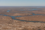 Aerial - The meandering waters of Cooper Creek, a rare occurence when these waters could one day  reach Lake Eyre. Upon our crossing, this water was still 70 km away from Lake Eyre.