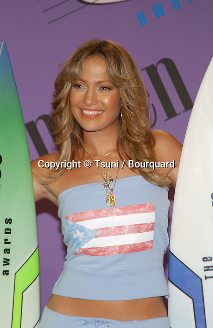 Jennifer Lopez backstage with her two awards at the Teen Choice Awards 2001 at the Universal Amphitheatre in Los Angeles Sunday, August 12, 2001. She won Choice Female Hottie and Choice Dance Track. Photo by &copy; Tsuni<br />           -            LopezJennifer01A.jpg